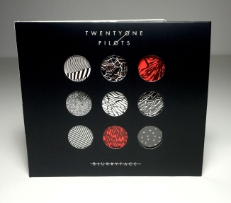 Album cover designer, Brandon Rike, gives a face to the character Blurryface by combining the elements of Twenty One Pilots as a band, but also what the album brings (Brandon RIke, web, http://brandonrike.com/behind-blurryface